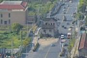 """Hô biến """"ngôi nhà cứng đầu"""" nhất Thượng Hải trong 90 phút"""
