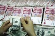 Đồng nhân dân tệ chạm mức thấp nhất 1 năm so với đồng USD