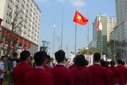Hình ảnh Quốc kỳ Việt Nam tung bay tại Lễ thượng cờ ASIAD 2018