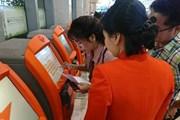 Khách đi máy bay làm thủ tục check-in trực tuyến tăng hơn 4 lần