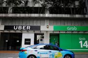 Grab 'mua đứt' Uber liệu có phải nộp thay khoản thuế 53,3 tỷ đồng?