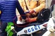 Hà Nội: Điều tra vụ cảnh sát giao thông nghi nhận tiền người vi phạm