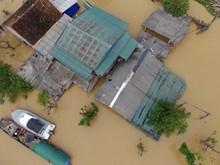 [Photo] Nước lũ sông Lam nhấn chìm nhiều xã ở Hưng Nguyên