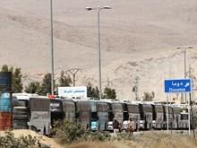 Syria: 2.000 người được sơ tán khỏi thành phố Harasta trong đợt đầu