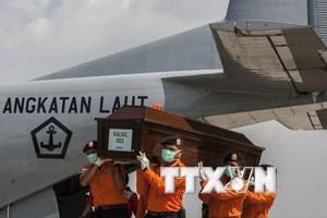 Hai gia đình nạn nhân của QZ8501 đã được nhận tiền bảo hiểm