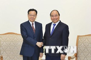 Thủ tướng Nguyễn Xuân Phúc tiếp Chủ tịch Khu tự trị dân tộc Choang