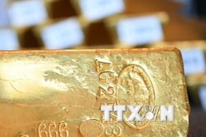 Đồng USD lên giá kéo giá vàng châu Á tiếp tục ở mức thấp