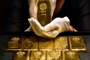 Giá vàng kỳ hạn đi xuống khi đồng USD từng bước phục hồi