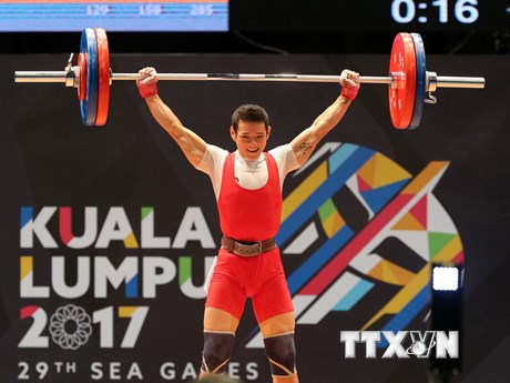 [Photo] Thạch Kim Tuấn đoạt huy chương vàng cử tạ hạng 56kg