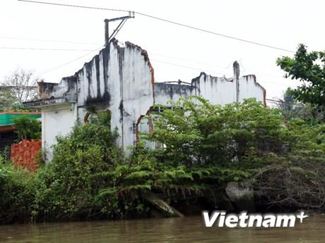 [Photo] Cuộc sống chênh vênh của người dân bên bờ kênh Chợ Gạo