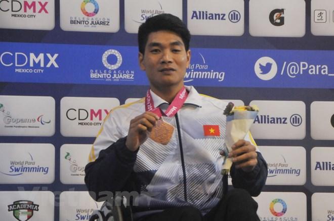 Vận động viên Đỗ Thanh Hải nhận Huy chương đồng. (Ảnh: Việt Hùng/Vietnam+)