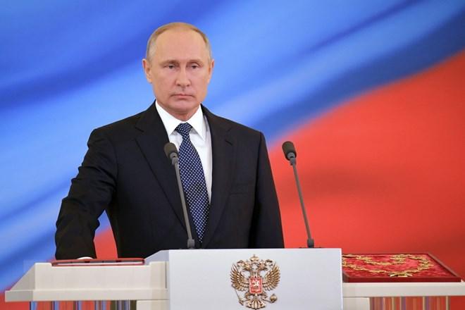 Tổng thống Vladimir Putin đọc lời tuyên thệ nhậm chức tại điện Kremlin ngày 7-5. Nguồn: AFP/TTXVN