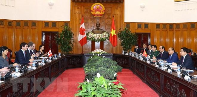 Thủ tướng Nguyễn Xuân Phúc và Thủ tướng Canada Justin Trudeau hội đàm tại Trụ sở Chính phủ, chiều 8/11. (Ảnh: Thống Nhất/TTXVN)