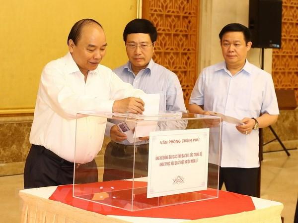 Lãnh đạo Đảng, Nhà nước quyên góp ủng hộ người dân vùng lũ - ảnh 2