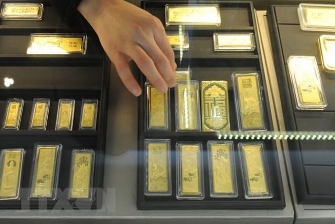 Vàng được bày bán tại một cửa hàng ở tỉnh An Huy, Trung Quốc. (Ảnh: AFP/TTXVN)